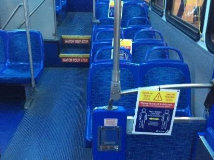 Signs Separating Riders Reduces Bus Capacity to 15 Riders